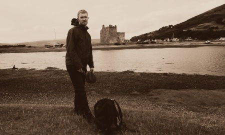 Moz looking exceptionally happy in front of an old ruined castle.